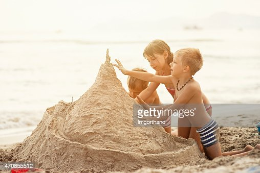 Kids building a giant sandcastle