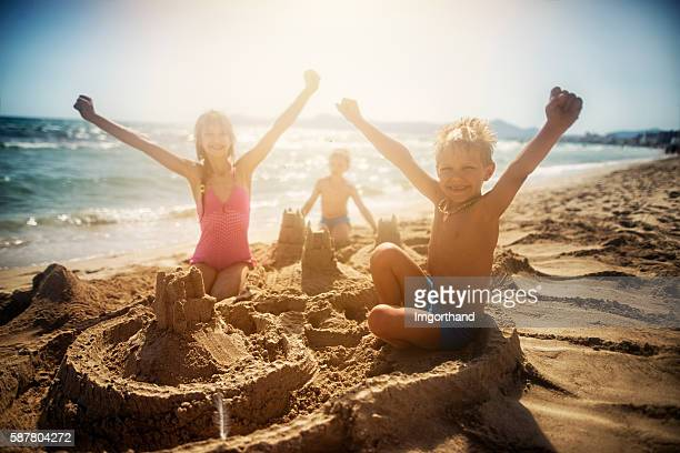 Kids building a sandcastle on a beautiful beach