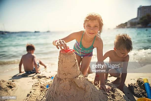 Kids building a sandcastle