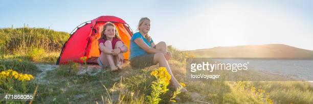 Kids camping idyllic golden beach dunes overlooking tranquil summer ocean