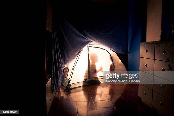 Kids camping indoors.