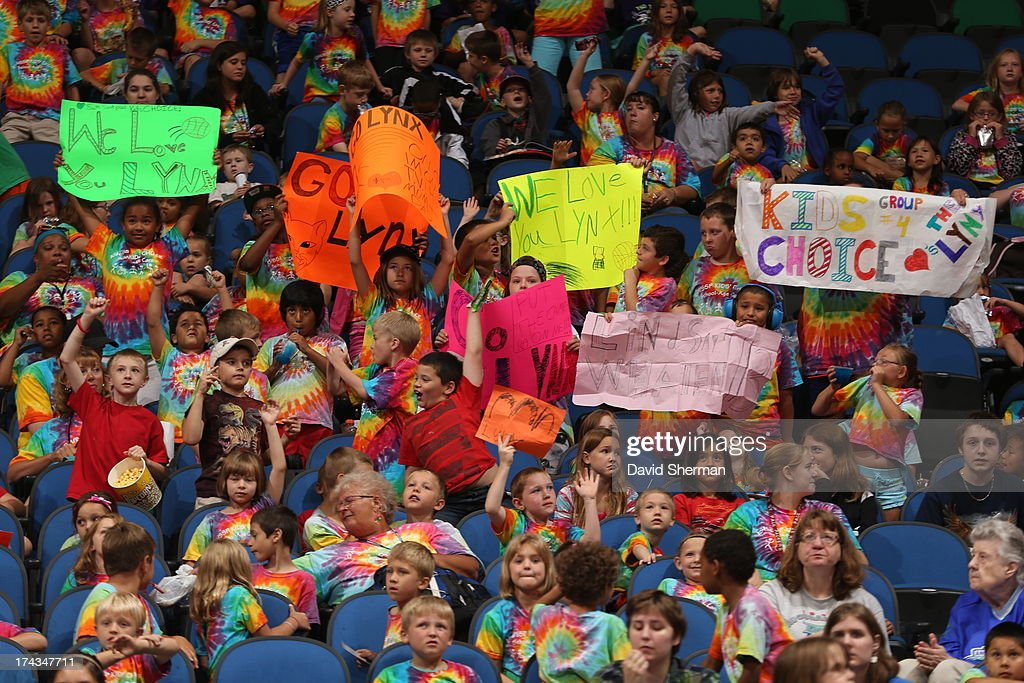 Kids cheer on the Minnesota Lynx during the WNBA game against the Phoenix Mercury on July 24, 2013 at Target Center in Minneapolis, Minnesota.