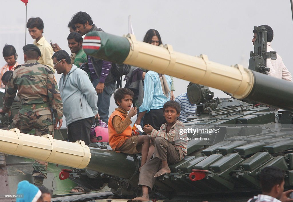 Kids climbed on a Patton Tank during 'Army Equipment Display and Military Tattoo' at Army Polo Ground, Race Course on February 2, 2013 in Kolkata, India.