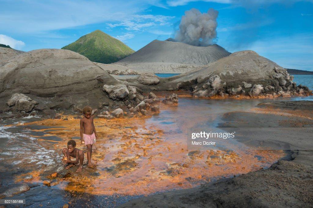 Kids cooking eggs in hot springs