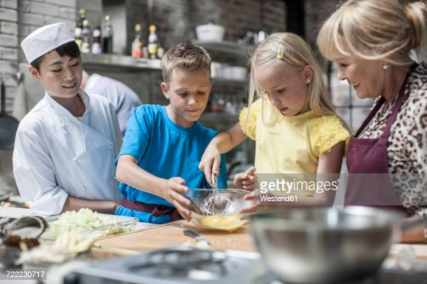 Kids cooking in cooking class