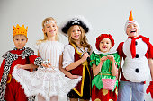 Several kids in different costumes having party