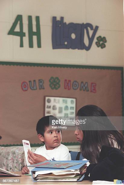 Kids doing homework during 4–H club meeting after school at Broadway Elementary School in Venice Photo from left are Jose Soriano 4yrs and Alma Lira...