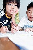 Kids doing homework, Japan