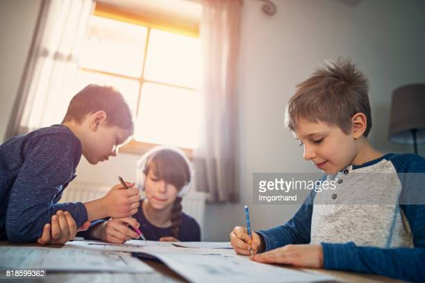 Kids doing their homeworks at home