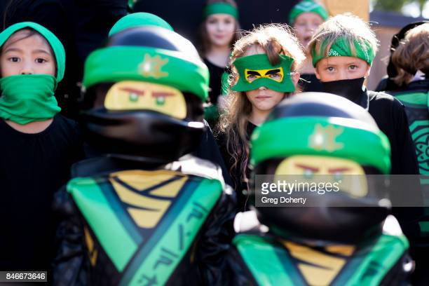 Kids dressed as Lloyd the Green Ninja pose at the Green Ninja Photo Opp With Dave Franco For Warner Bros Pictures' 'The LEGO Ninjago Movie'at...