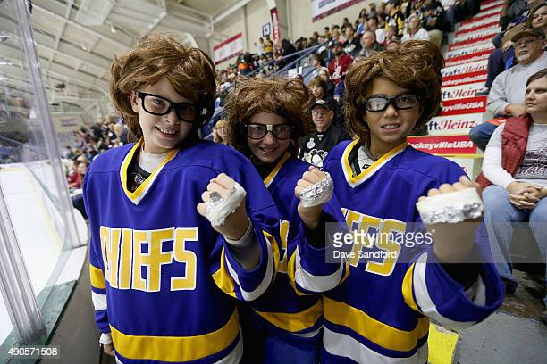 Kids dressed as the characters the Hanson brothers from the movie 'Slap Shot' pose before the start of the NHL Kraft Hockeyville USA preseason game...