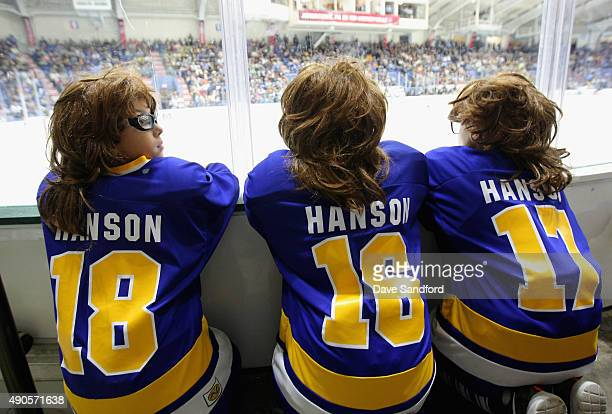Kids dressed as the Hanson brothers characters from the movie 'Slap Shot' wait for the start of the NHL Kraft Hockeyville USA preseason game between...