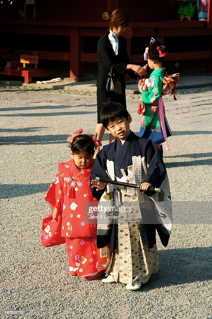 Kids dressed in traditional kimono for 'shichi-go-san'. Seven (shichi), five (go) and three (san) year-old kids visit shrines to celebrate and pray for health and good fortune. Traditionally set on November 15th, this event now takes place throughout the month, here at Tsurugaoka Shrine, Kamamura..
