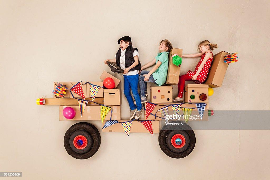 Kids driving to party, having fun