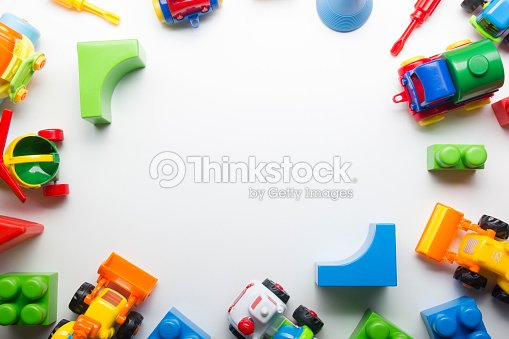 Kids educational developing toys frame on white background. Top view. Flat lay. Copy space for text : Stock Photo