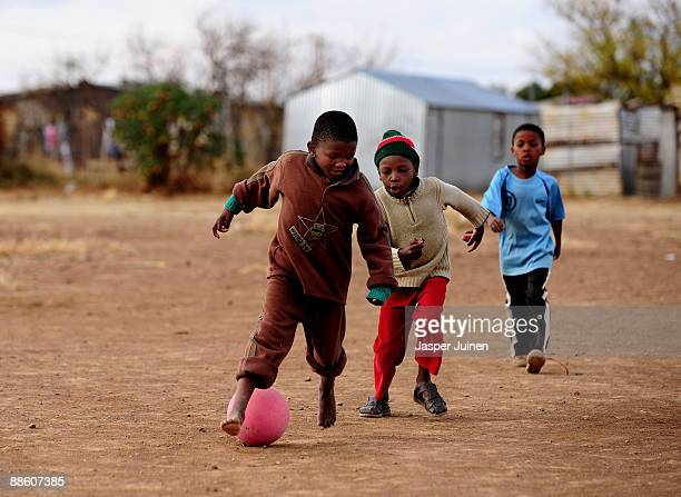Kids enjoy a game of football on June 21 2009 in Botshabelo near Bloemfontein South Africa The large black settlement of Botshabelo set up by the...