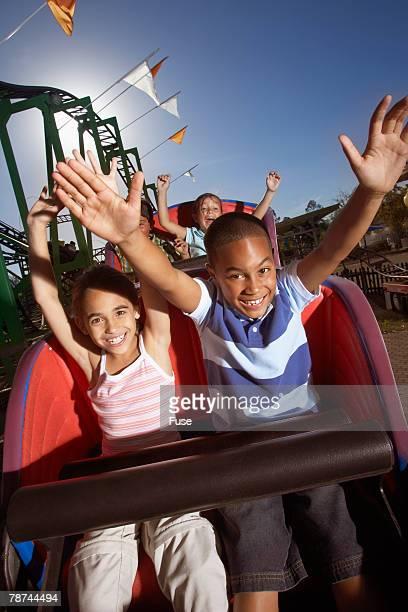 Kids Enjoying a Roller Coaster