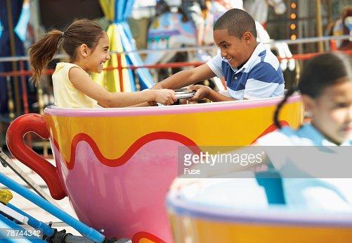 Kids Enjoying a Tea Cup Ride at the Fair