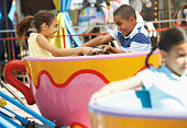 Kids Enjoying a Tea Cup Ride at the Fair