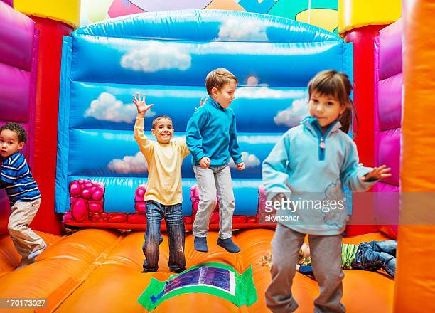 Kids enjoying in bouncy castle.
