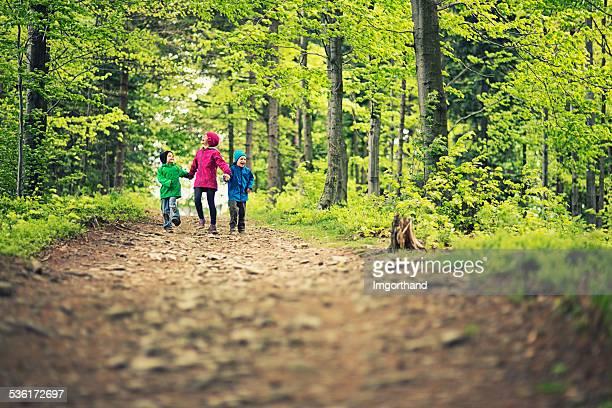 Kids enjoying in spring forest