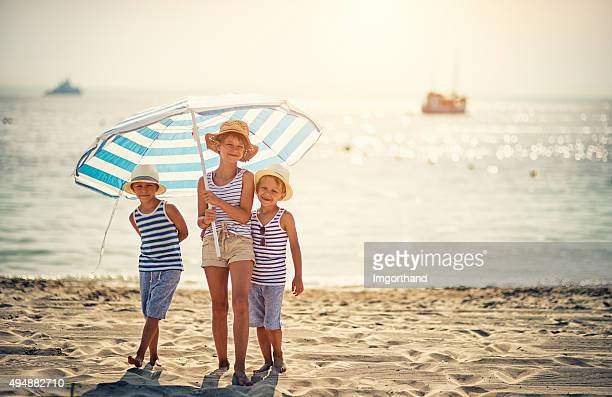 Kids enjoying summer vacation on the beach