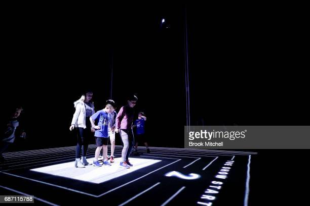 Kids enjoying the Trapdoor installation ahead of the Vivid Festival at Barangaroo Park Sydney Trapdoor is described by its creators as an optical...