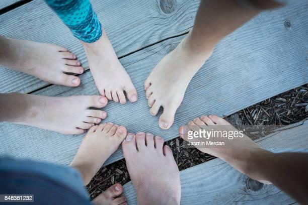 Kids feet in circle