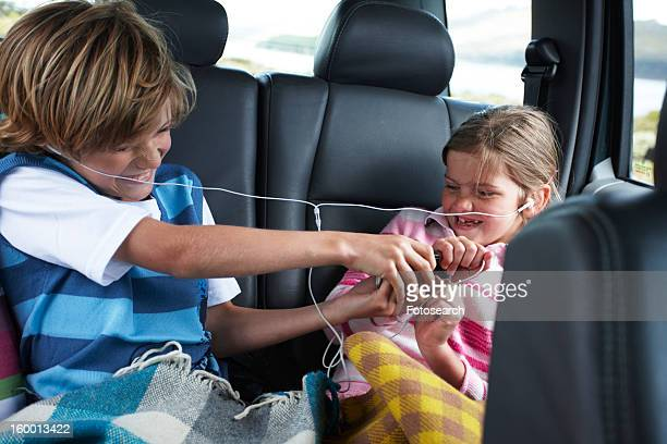 Kids fighting in the back of a car