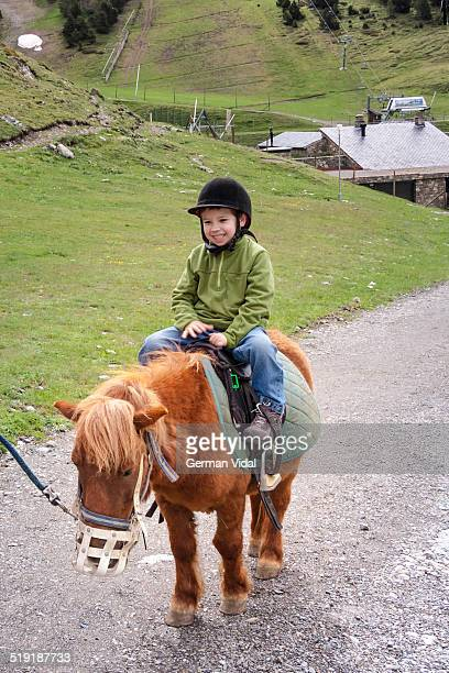 Kid's first ride on a pony, Vall de Nuria (Spain)