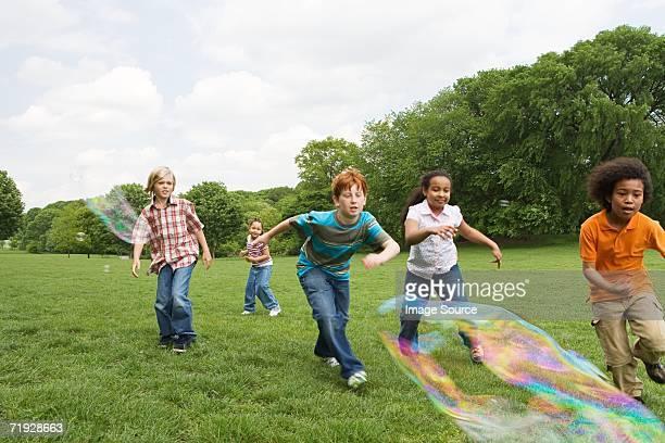 Kids following bubbles