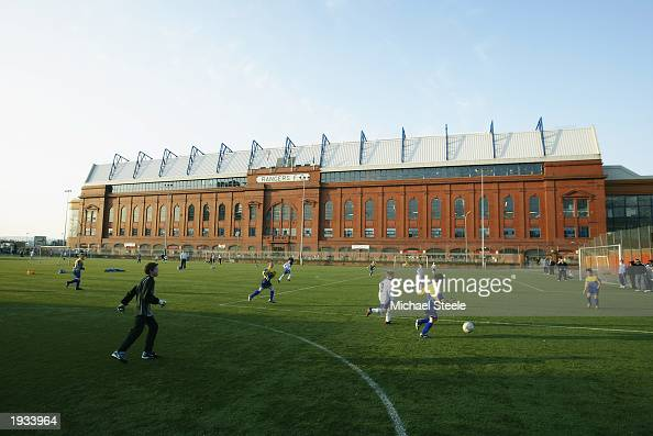 Kids football takes place outside Ibrox Stadium during the Tennents Scottish Cup fifth round replay match between Glasgow Rangers and Dunfermline...