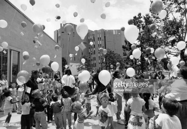 Kids galore were on hand for a balloon release celebrating the 100th Birthday of the Denver Public Library Each balloon carried a message about the...
