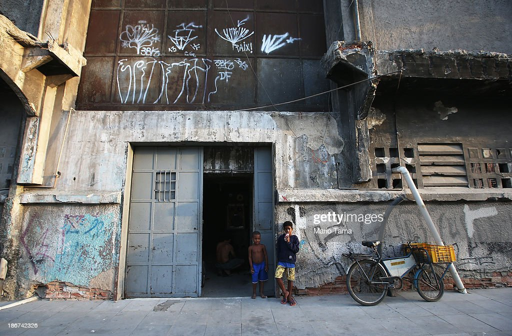 Kids gather in front of a formerly deserted bullding which is currently home to 82 families who occupy the building in the port district on November 3, 2013 in Rio de Janeiro, Brazil. Residents say the building has been occupied for the past 14 years and government officials have informed the residents that they will be relocated to new housing in the North Zone of the city ahead of the 2014 World Cup. Some residents doubt the intentions of the government. Ahead of the 2014 World Cup and Rio 2016 Olympic Games, Rio has started a multibillion dollar urban renewal program of its port district which includes a double decker waterfront freeway being torn down to be replaced by tunnels, repaved roads, a tram network and other infrastructure improvements in the area. The 'Porto Maravilha' project is also expected to displace around 1,000 local residents.