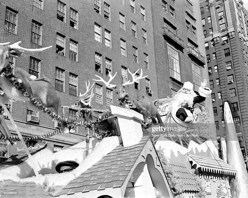 Kids get preview of Santa Claus as he waves from float during Macy's Thanksgiving Day parade.