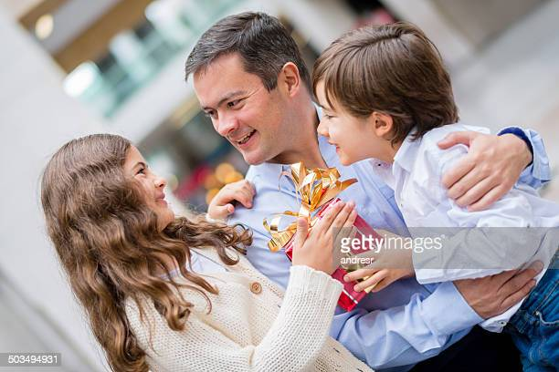 Kids giving father a present