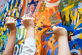 Kids hands with Colourful Paint Background Art and Creative Education