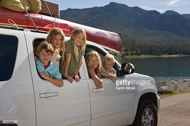 Kids hanging out of back of SUV