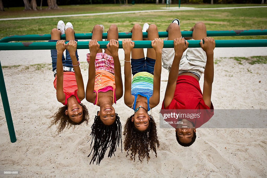 Kids Hanging Upsidedown Stock Photo | Getty Images