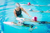 Little swimmers - Kids having a race in swimming class