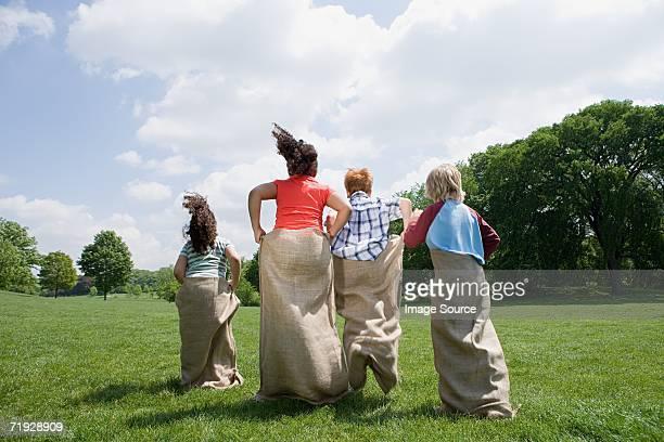 Kids having a sack race