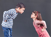 Brother and sister having an argument. Family relationships concept