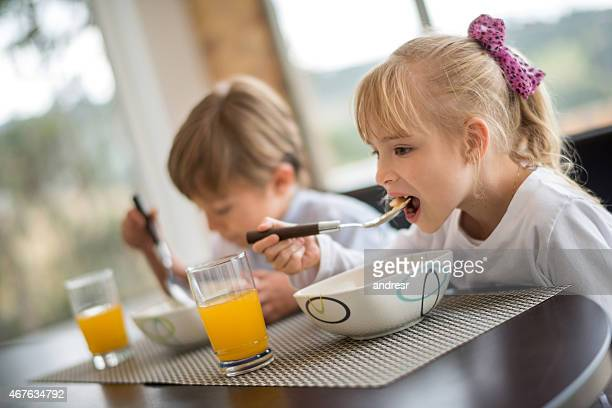 Kids having breakfast in the morning