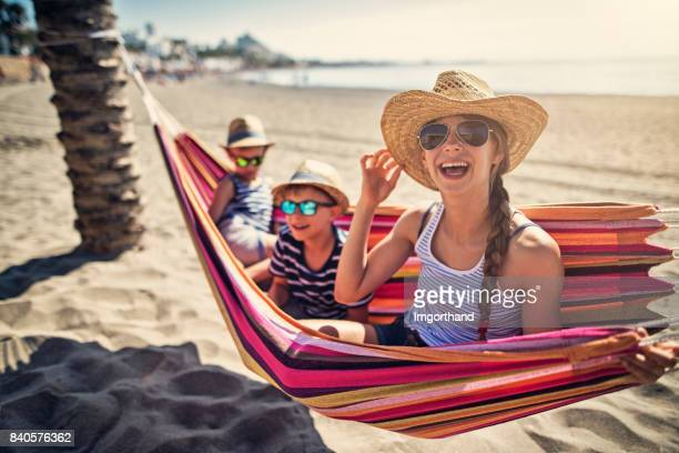 Kids having fun on hammock on beach