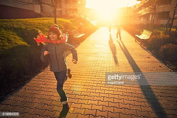 Kids having fun runnin on sunset