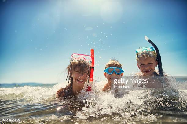 Kids having fun snorkeling in beautiful sea