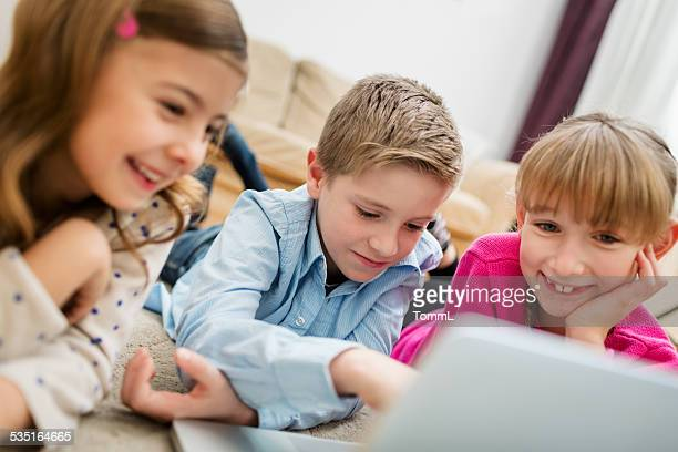 Kids Having Fun With Computer