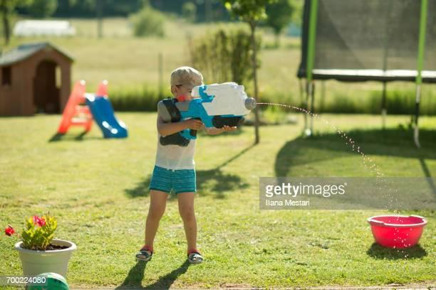 Kids having fun with water pistols