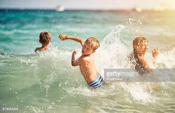 Kids having ultimate fun in sea waves