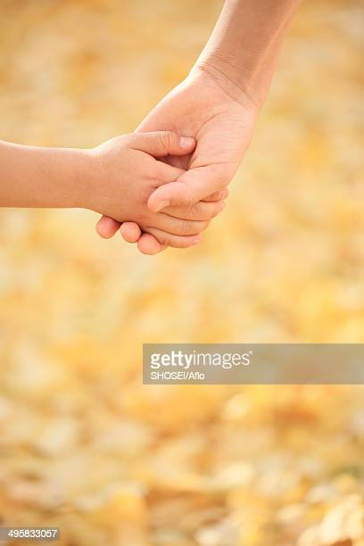 Kids holding hands, Japan